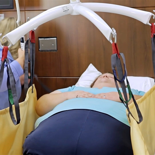 Bariatric Repositioning sling learning video - Lifting patient from floor to bed