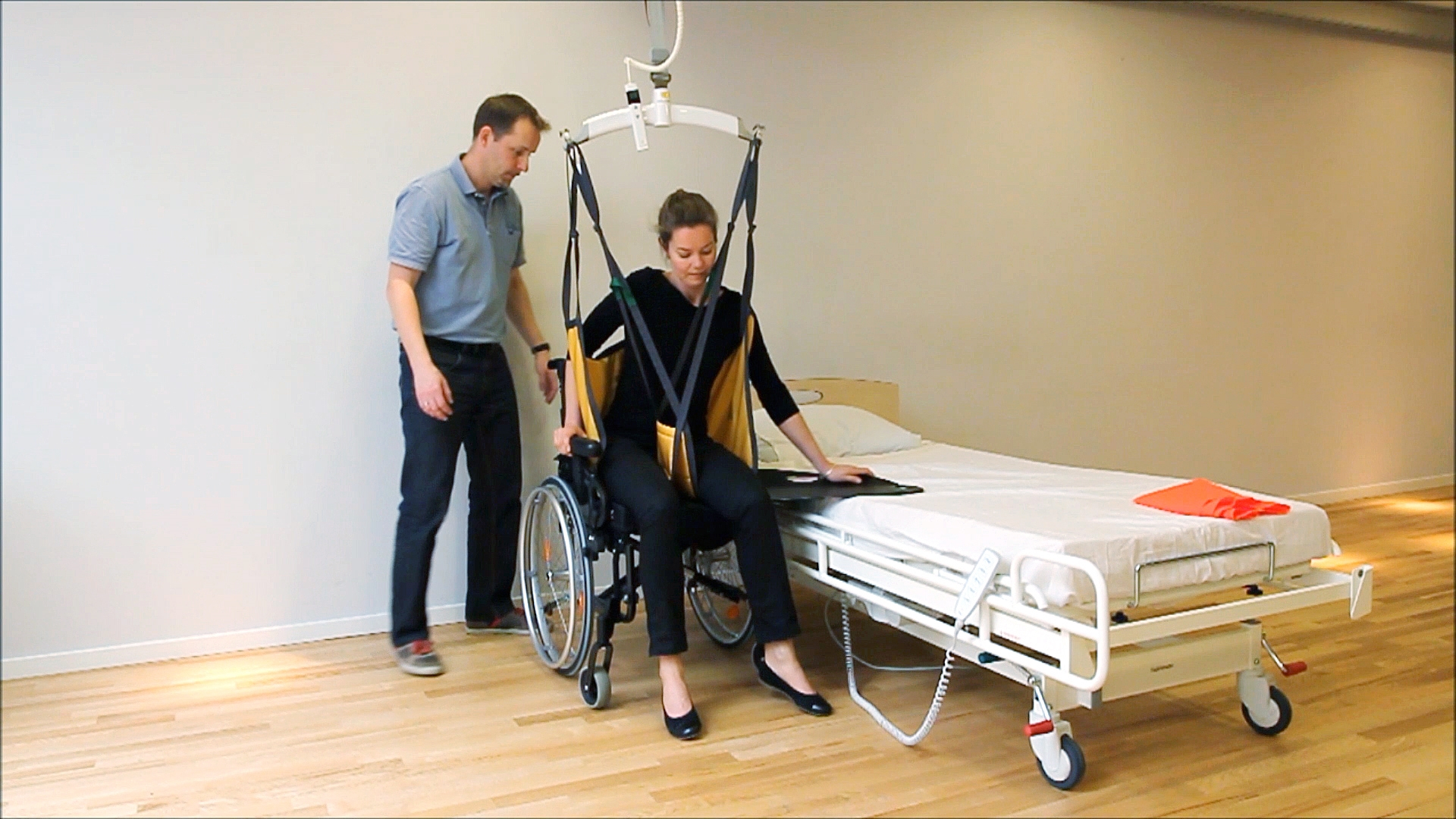 Rehabilitation of the patient - getting from wheelchair to bed