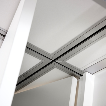 Rail crossing is used to set up a flexible solution involving mobile wall units and revolving/folding doors integrated with a ceiling lift system